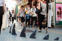 В Азии социальные и политические проблемы изображают прямо на улицах